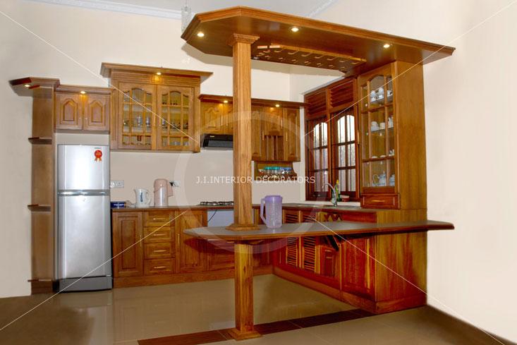 J i interior decorators gallery pantry cupboards bed for Interior designs cupboards